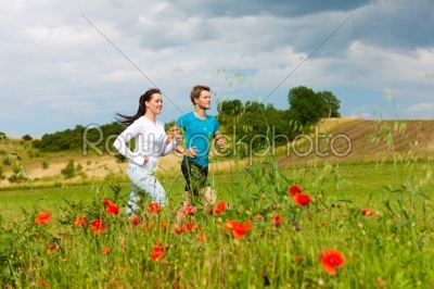 stock photo: young sportive couple is jogging outside-Raw Stock Photo ID: 42361