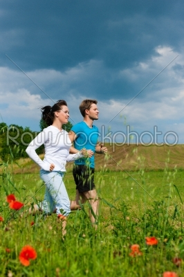 stock photo: young sportive couple is jogging outside-Raw Stock Photo ID: 42363