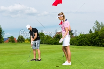 stock photo: young sportive couple playing golf on a course-Raw Stock Photo ID: 45880