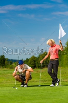 stock photo: young sportive couple playing golf on a course-Raw Stock Photo ID: 46097