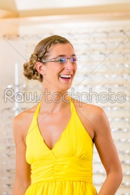 stock photo: young woman at optician with glasses-Raw Stock Photo ID: 45779