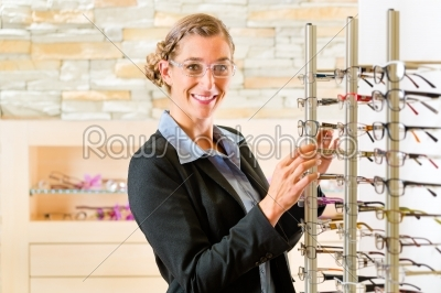 stock photo: young woman at optician with glasses-Raw Stock Photo ID: 45803