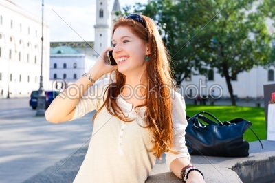 stock photo: young woman calls with mobile phone in the park-Raw Stock Photo ID: 46152