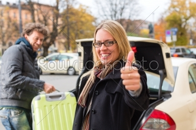 stock photo: young woman in front of taxi-Raw Stock Photo ID: 46892