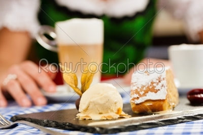 stock photo: young woman in traditional bavarian tracht in restaurant or pub-Raw Stock Photo ID: 44041