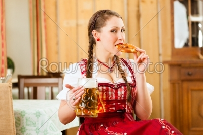 stock photo: young woman in traditional bavarian tracht in restaurant or pub-Raw Stock Photo ID: 44089