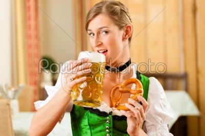stock photo: young woman in traditional bavarian tracht in restaurant or pub-Raw Stock Photo ID: 44093