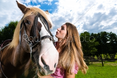 stock photo: young woman on the meadow with horse and kissing-Raw Stock Photo ID: 45999