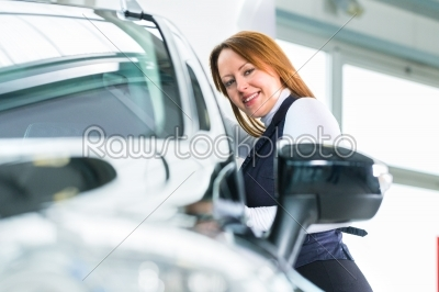 stock photo: young woman with auto in car dealership-Raw Stock Photo ID: 38680