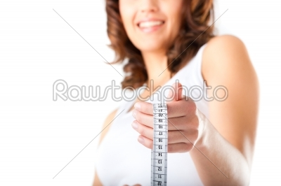 stock photo: young woman with measuring tape-Raw Stock Photo ID: 43894