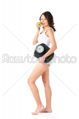 stock photo: young woman with scale under her arm and apple-Raw Stock Photo ID: 43864