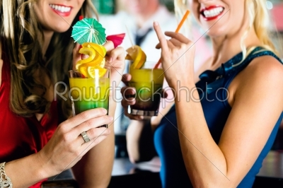 stock photo: young women with cocktails in club or bar-Raw Stock Photo ID: 46587