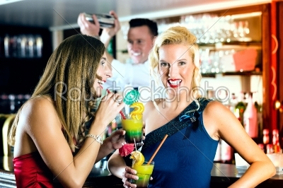 stock photo: young women with cocktails in club or bar-Raw Stock Photo ID: 46597