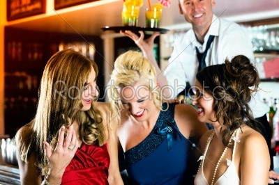 stock photo: young women with cocktails in club or bar-Raw Stock Photo ID: 46612