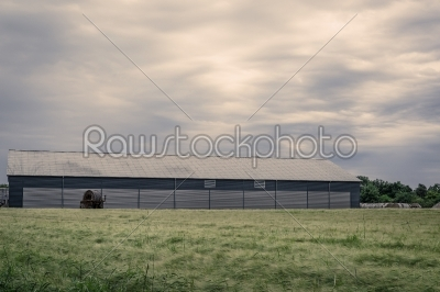 stock photo: agriculture barn on a green field-Raw Stock Photo ID: 69809