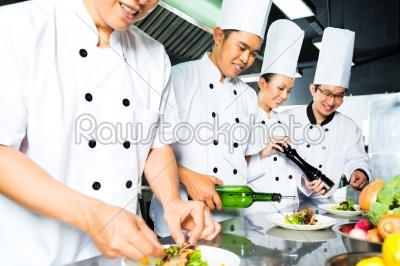 stock photo: asian chef in restaurant kitchen cooking-Raw Stock Photo ID: 49776