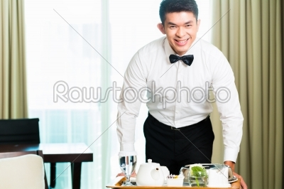 stock photo: asian chinese room waiter serving guests food in hotel-Raw Stock Photo ID: 49580