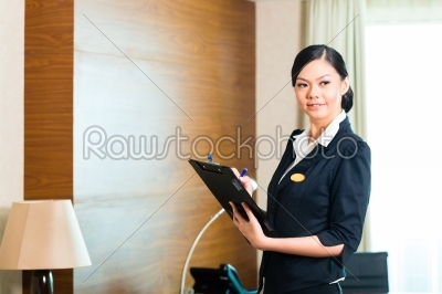 stock photo: asian executive housekeeper controlling hotel room-Raw Stock Photo ID: 49587