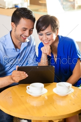 stock photo: asian woman and man in an coffee shop-Raw Stock Photo ID: 48479