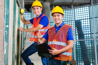 stock photo: asian worker controlling building on construction site-Raw Stock Photo ID: 49459