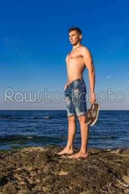 stock photo: attractive handsome sexy naked young man on rock near the sea-Raw Stock Photo ID: 67631