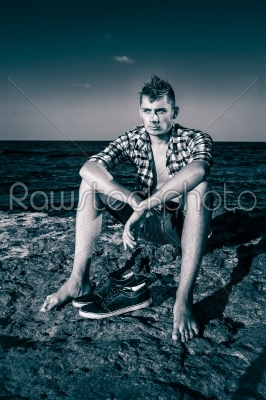 stock photo: attractive young fashion sexy man on rock near the sea water in -Raw Stock Photo ID: 67640