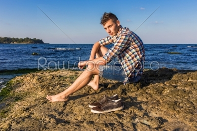 stock photo: attractive young fashion sexy man on rock near the sea water-Raw Stock Photo ID: 67634