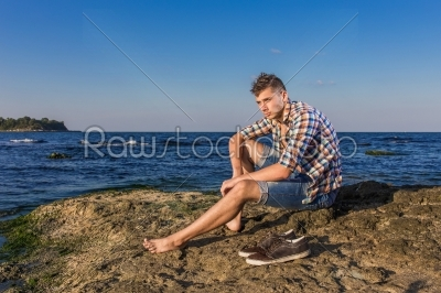 stock photo: attractive young fashion sexy man on rock near the sea water-Raw Stock Photo ID: 67636