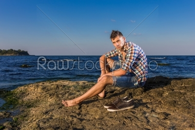 stock photo: attractive young fashion sexy man on rock near the sea water-Raw Stock Photo ID: 67637