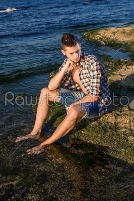 stock photo: attractive young fashion sexy man on rock near the sea water-Raw Stock Photo ID: 67646