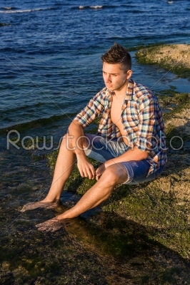 stock photo: attractive young fashion sexy man on rock near the sea water-Raw Stock Photo ID: 67648