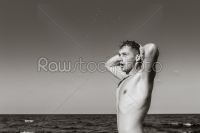 stock photo: attractive young man in the sea getting out of water-Raw Stock Photo ID: 67599