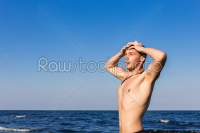 stock photo: attractive young man in the sea getting out of water-Raw Stock Photo ID: 67600