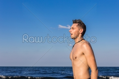 stock photo: attractive young man in the sea getting out of water-Raw Stock Photo ID: 67604