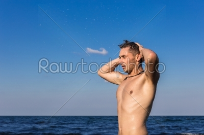 stock photo: attractive young man in the sea getting out of water-Raw Stock Photo ID: 67605