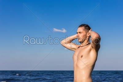 stock photo: attractive young man in the sea getting out of water-Raw Stock Photo ID: 67608