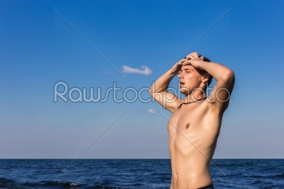 stock photo: attractive young man in the sea getting out of water-Raw Stock Photo ID: 67612