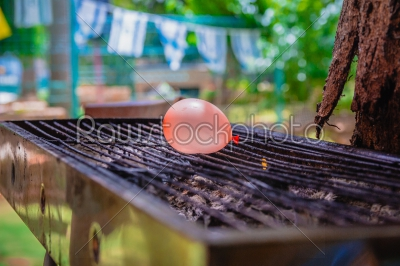 stock photo: balloon filled with water placed on a hot grill-Raw Stock Photo ID: 75164