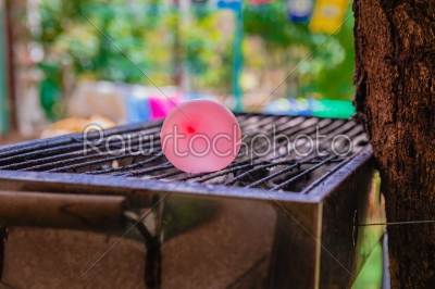 stock photo: balloon filled with water placed on a hot grill-Raw Stock Photo ID: 75166