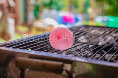 stock photo: balloon filled with water placed on a hot grill-Raw Stock Photo ID: 75167