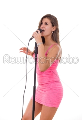 stock photo: beautiful girl holding microphone and singing in a dress-Raw Stock Photo ID: 52463