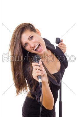 stock photo: beautiful girl holding microphone and singing loud in black dres-Raw Stock Photo ID: 52464