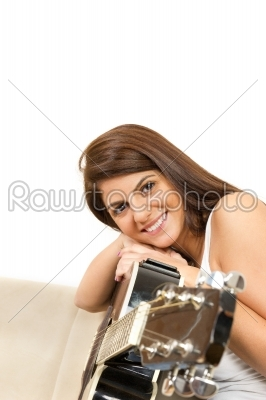 stock photo: beautiful girl with a guitar smiling-Raw Stock Photo ID: 52216