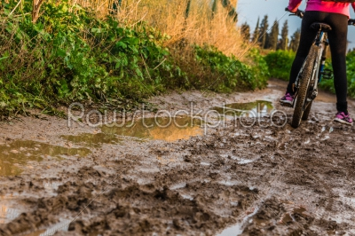 stock photo: bicycle ride through muddy dirt road-Raw Stock Photo ID: 75138