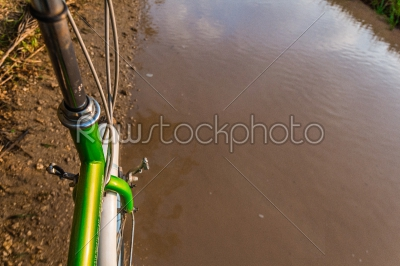 stock photo: bicycle ride through muddy dirt road-Raw Stock Photo ID: 75139