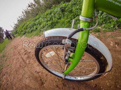 stock photo: bicycle ride through muddy dirt road-Raw Stock Photo ID: 75142