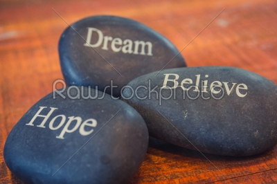 stock photo: black inspirational pebble stones with the words dream believe -Raw Stock Photo ID: 75173