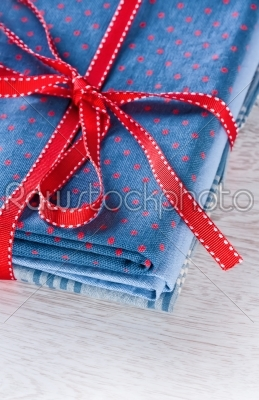 stock photo: blue fabric pile with red ribbon-Raw Stock Photo ID: 68229