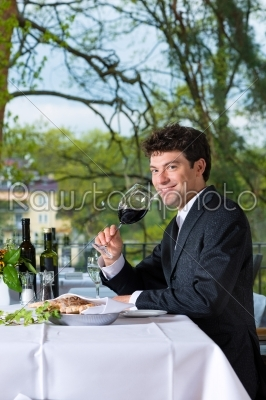 stock photo: businessman has lunch in restaurant-Raw Stock Photo ID: 48561