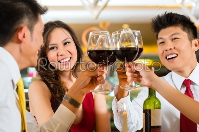 stock photo: chinese couples toasting with wine in restaurant-Raw Stock Photo ID: 49546